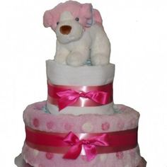 A cute nappy cake made with two tiers of nappies and soft plush puppy toy, perfect for somebody who is expecting a baby or just had a baby. Baby Girl Cakes, Nappy Cakes, Toy Puppies, Expecting Baby, Having A Baby, How To Make Cake, Puppy Love, Baby Girls, Plush