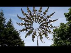 Hypnotizing wind machine. These are beyond amazing! Click here to see more: http://www.thisiscolossal.com/2013/06/hypnotic-wind-powered-kinetic-sculptures-by-anthony-howe/