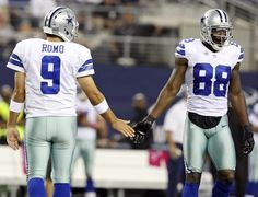 Dallas Cowboys' Tony Romo (left) and Dallas Cowboys' Dez Bryant slap hands after a play during first half action against the Chicago Bears Monday; Bears won 34-18