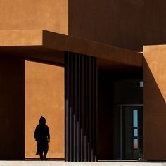 The harsh sunlight inthe Moroccan desert castsdramaticshadows across the sandy red walls of this university