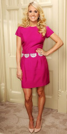 Carrie Underwood chose bright fuchsia Katherine Feiner separates for a portrait leading up to her Country to Country performance in London, pairing the outfit with sparkling Swarovski jewels and classic nude pumps.
