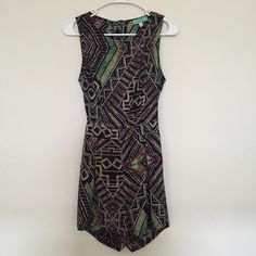 Printed romper Beautiful Aztec printed romper in perfect condition. A cut out in the back that exposes your lower back and buttons to the top. Zippers at the shorts. Listed nasty gal for exposure bought from boutique Nasty Gal Pants Jumpsuits & Rompers