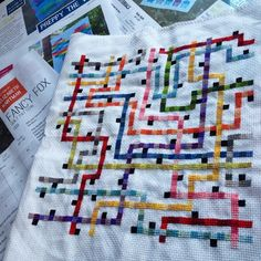 Finally finished stitching my #tokyosubwaymap #crossstitch  stack of Elizabeth Hartman #patterns on deck #makealltheprettythings #quilting #inspirationeverywhere