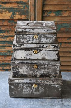 tattered old metal boxes in a stack