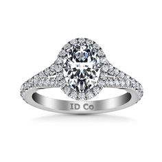 HALO ENGAGEMENT RING IN  14K WHITE GOLD