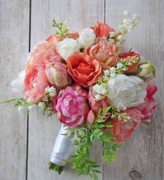 Love the mix of peonies and roses in this bridal bouquet plus I added a few springs of lily of the valley. Perfect for spring or summer! #silkflowerbouquet #bouquet #bridalbouquet #pinks #corals #weddingbouquet #peonies #peonybouquet #weddings #etsy #afloral #afloraldesigner Design by Andrea Justannsfloral
