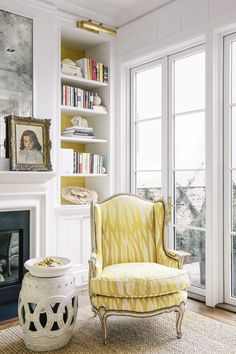 Yellow upholstered armchair in corner of living room