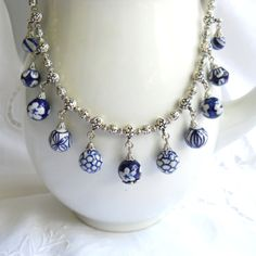 Delft blue necklace, Delft blue jewelry, Delft, Holland, blue necklace, blue and white, dangle necklace. €32.50, via Etsy.