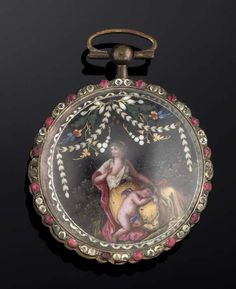 AN 18TH CENTURY GILT AND ENAMEL OPEN FACE POCKET WATCH The circular dial with white enamel and black Roman numeral plaque design chapter ring engraved in the centre with twin figures of pan, to a white and red paste bezel, the gilt verge movement with pierced foliate engraved balance cock and triple arm balance wheel, the case reverse with swiss enamel panel depicting the draped figure of Venus with Eros below against a black ground with foliate canopy, the case possibly a later adaptation