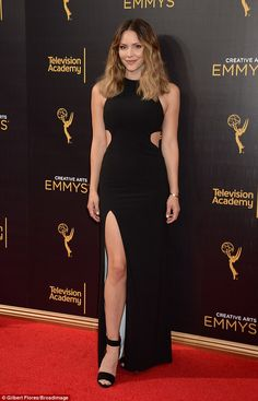 Flash that leg! Katharine McPhee stunned in a cut-out black dress for the Creative Arts Emmy Awards on Sunday in Los Angeles