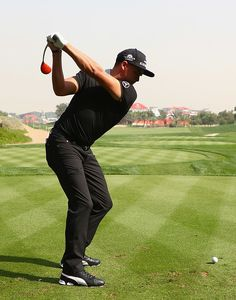 Rickie Fowler of the United States driver swing sequence frame 6 of 12 during a practice round ahead of the Abu Dhabi HSBC Championship at Abu Dhabi Golf Club on January 17, 2017 in Abu Dhabi, United Arab Emirates.