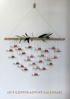 DIY Copper Advent Calendar / 5 calendarios de adviento handmade. Ideas para inspirarse y hacer un precioso calendario de adviento en casa