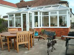 White PVCu P-Shape Conservatory, Dwarf Wall Model. Manufactured and supplied by ConservatoryLand DIY Conservatories. Photo kindly supplied by our customer.