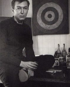 Jasper Johns photographed in his studio by Robert Rauschenberg, 1955.