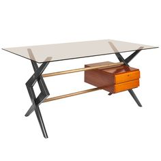 Midcentury Italian Desk in the manner of Paolo Buffa for Dassi   From a unique collection of antique and modern desks at https://www.1stdibs.com/furniture/storage-case-pieces/desks/