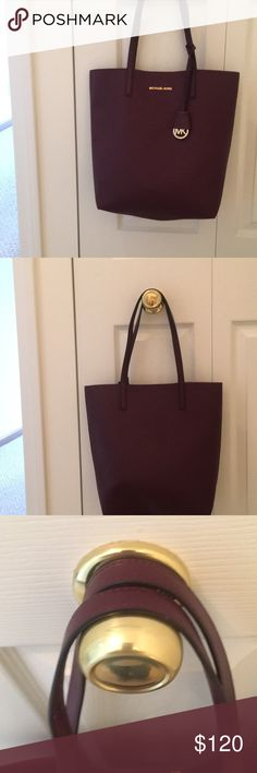 007937254f8430 Michael Kors large tote Gently used Michael kors tote. The color Of the  tote is either a dark maroon red or a dark purple.