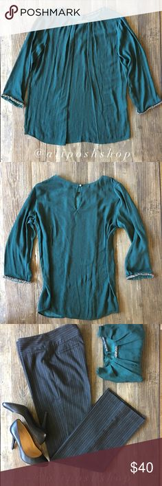 NWOT Zara sequin embellished blouse NWOT Zara sequin embellished blouse 🔹Gorgeous emerald color 🔹Sequin neck and sleeve embellishment  🔹Crystal button back closure 🔹Front draping 🔹3/4 sleeve 🔹Brand new Zara Tops Blouses