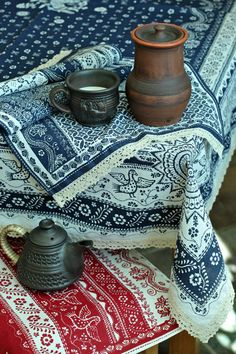 Linen table cloth and towels with traditional Russian print.