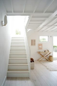 Interior Architecture, Detailing and Photography by Kevin Greenberg of Space Exploration. Foyer Inspiration. White Foyer. Staircase Inspiration. Boho Entryway. White Stairway. Boho Design.