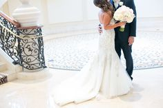 pure lavish events | st. regis monarch beach | blush and white wedding | luxury wedding | black tux | bride and groom | grand staircase | florals by Jenny | kaysha weiner photography | bride bouquet | peonies | garden roses