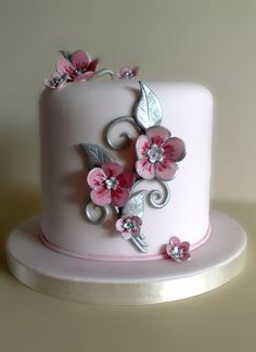 Pretty little pink and silver flower cake