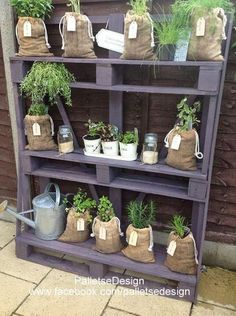 Garden shelves from pallets would be good for event decor as well Herb Garden Pallet, Diy Herb Garden, Pallets Garden, Garden Web, Plant Theatre, Small Herb Gardens, Garden Shelves, Recycled Pallets, Recycled Materials