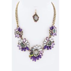 Purple Mix Crystal & Stone Statement Necklace Set Beautiful Stone and Crystal Statement Necklace Set features multicolored purple and white stones arranged in flowers along an antiquated gold plated chain (Not real Gold). Also comes with a pair of round stone earrings. Very pretty and perfect for Spring! Step out and make a statement Jewelry Necklaces