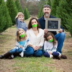 Deck The Gals With Neon Duct Tape Photographer Declares Peace On Earth By Silencing Women In Familys Holiday Photo