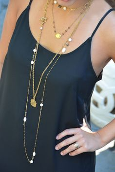 Holiday Attire.  Layered necklaces by ExVoto Vintage Jewelry with a simple black dress
