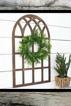 This oversized faux cathedral style window is stunning! This piece makes a huge statement at and would be so cute with a seasonal wreath attached to it. #farmhousedecor #ad #farmhouse #decorations
