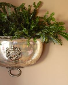 Silver and pine. (Do something like this with the silver ice buckets I keep finding . . . for centerpieces?)