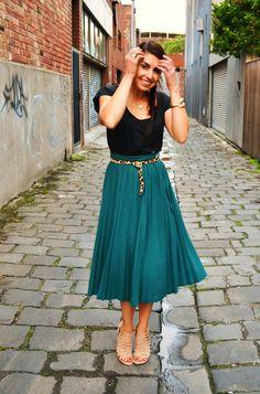 Black top, cheetah belt and teal skirt! Great!!