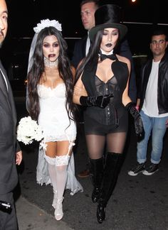 She's finally a bride! Kourtney Kardashian (l.) and a female friend dressed up as a dead bride and groom as they made their way to a Halloween party on Oct. 29, 2016.