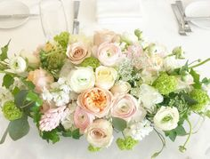 Springy hyacinth, Queen Anne's lace, lisianthus, #gardenroses, viburnum and ranunculus. #weddingcenterpiece