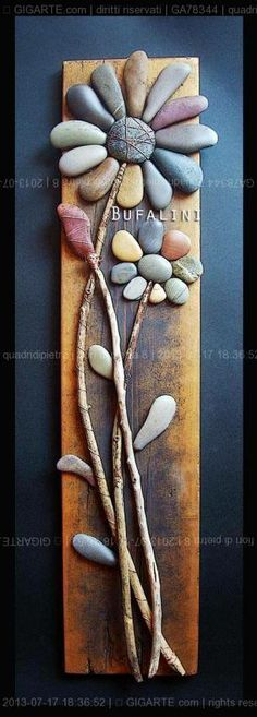 This beautiful craft using stones and a few branches was created by Michela Bufalini.