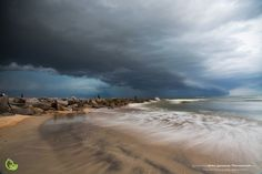 Storm blowing in over the jetties at Vilano Beach, north of St. Augustine by Robin Anderson Photography, Florida landscape.