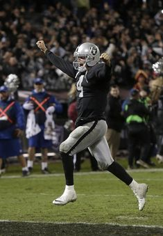 Derek Carr celebrates his first career victory in the NFL.