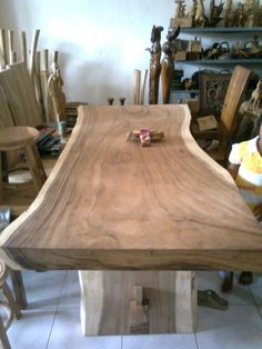 Suar Wood Table - really like the idea of the 'live edge' on this table!
