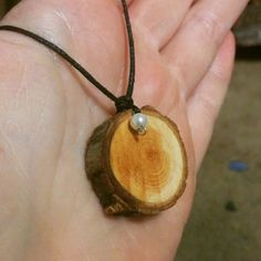 Natural wood slice difuser necklace by perfumesforthehandke