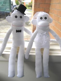 Set of 2 monkeys , wedding bride and groom handmade sock monkeys . They are unique one of a kind handmade sock monkeys . Great for wedding gift & wedding decoration .    Size approx : 29cm tall    They are handmade from brand new ( never been worn) socks , lace , flowers and felt... I make th...
