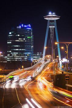 As they enter the bridge, Bratislava, Slovakia . Book Visit SLOVAKIA now via… Montenegro, Bósnia E Herzegovina, Bratislava Slovakia, Heart Of Europe, By Train, Central Europe, Eastern Europe, Romantic Travel, City Lights