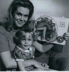"This photo was originally used to promote moving from 9:00/8:00 PM Central to 8:30/7:30 PM Central beginning with Season Three's ""Ho Ho the Clown."" So cute! Bewitched Elizabeth Montgomery, Time Clock, Find Picture, It Cast, Cute, Kawaii"