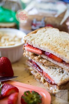 The Ultimate Strawberry PB&J // Who says peanut butter and jelly sandwiches have to be boring? This double-decker knockout creation made with @killerbreadman has two extra special add-ins. Come see what they are and how to make this mouth-watering pb&j! | Tried and Tasty