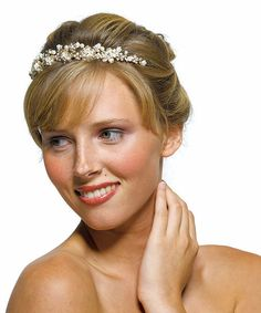 Be a princess for a day with our Ivory Pearls in Antique Gold Garden Bridal Tiara!