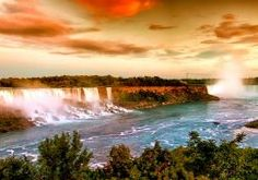 nature landscapes waterfall trees rivers spray fog mist water cliff sky clouds sunset sunrise color scenic view