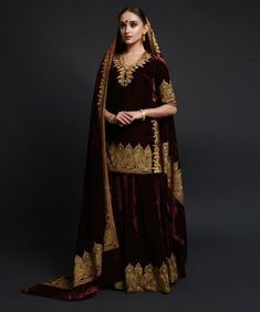 Adorned with Kashmiri silver tilla embroidery, this velvet saree will have all eyes on you. The silver tilla embroidery adorns the saree pallav and borders. The tilla embroidered border along the skirt length of the saree is inches wide. Pakistani Wedding Outfits, Pakistani Bridal, Pakistani Dresses, Indian Dresses, Indian Outfits, Punjabi Bride, Bridal Lehenga, Punjabi Suits, Indian Bridal