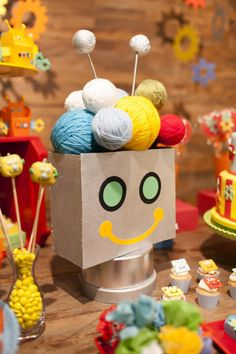 Such a creative display at a Robot Party with So Many Awesome Ideas via Kara's Party Ideas KarasPartyIdeas.com #RobotParty #PartyIdeas #PartySupplies