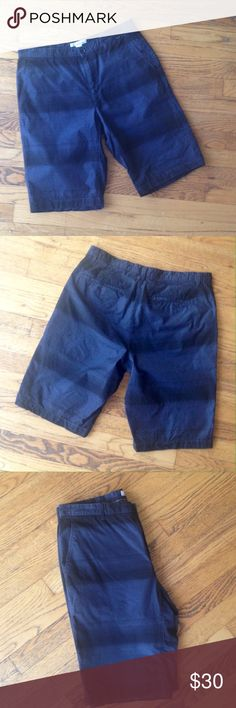 """NWOT Calvin Klein Men's Shorts Dark navy blue and black horizontal stripes in an almost an ombré style adorn these CK brand shorts. They've never been worn and are in perfect condition. Functional hip and back pockets, zip fly. Measurements (laying flat): waist: 30"""", inseam: 11"""", outseam:20.5"""", front rise: 20"""", back rise: 15"""" Calvin Klein Shorts Flat Front"""
