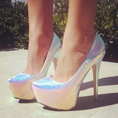 Holographic heels make even more perfect by making them snake skin.