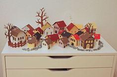 gorgeous little christmas advent village (website in german) with instructions for the houses here:  http://www.deschdanja.ch/kreativ-blog/75-adventskalender-winterstadt-2